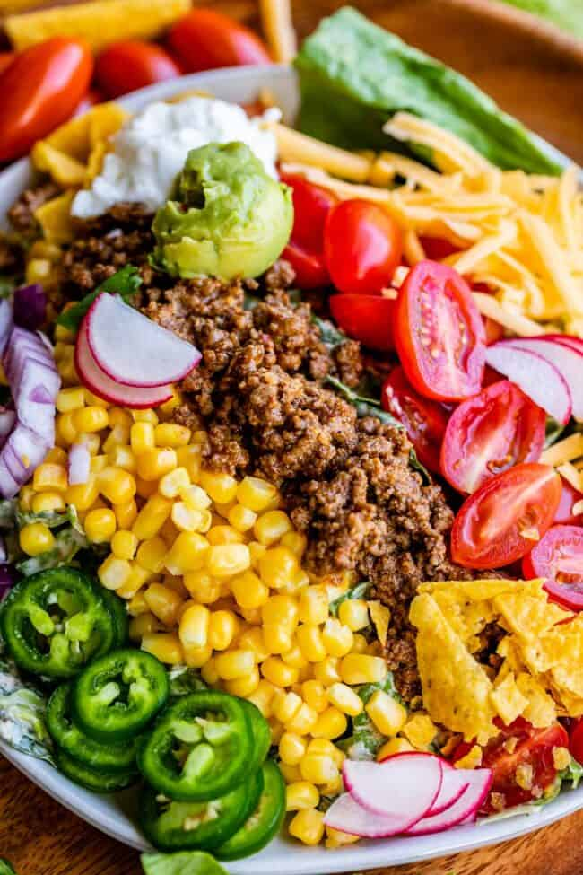 taco salad recipe ingredients lined up on a plate