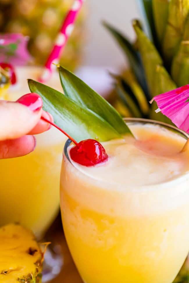 virgin pina coladas in goblets with cherry
