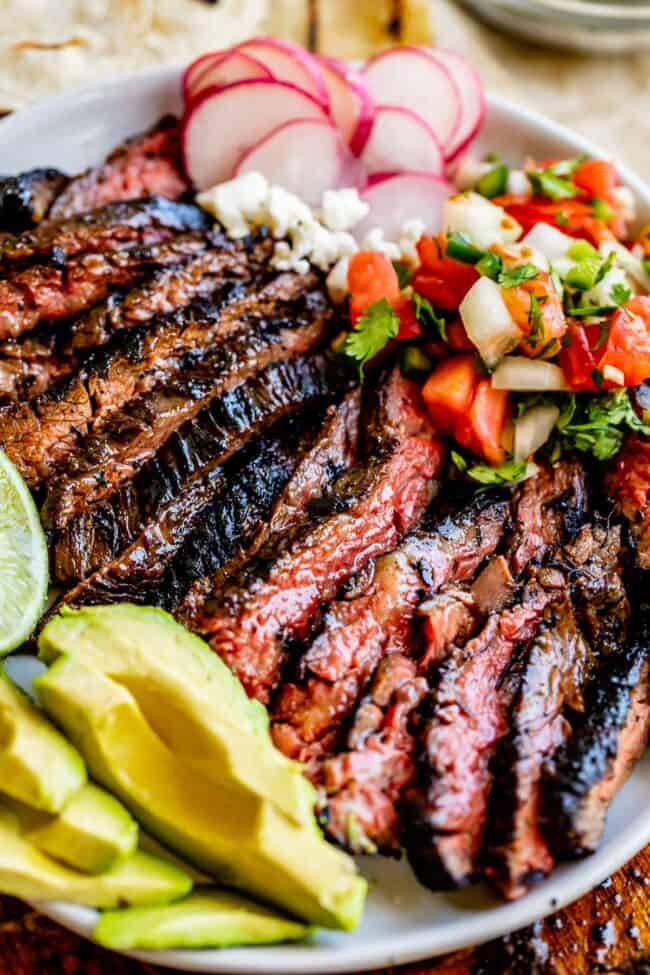 carne asada recipe on a place with garnishes