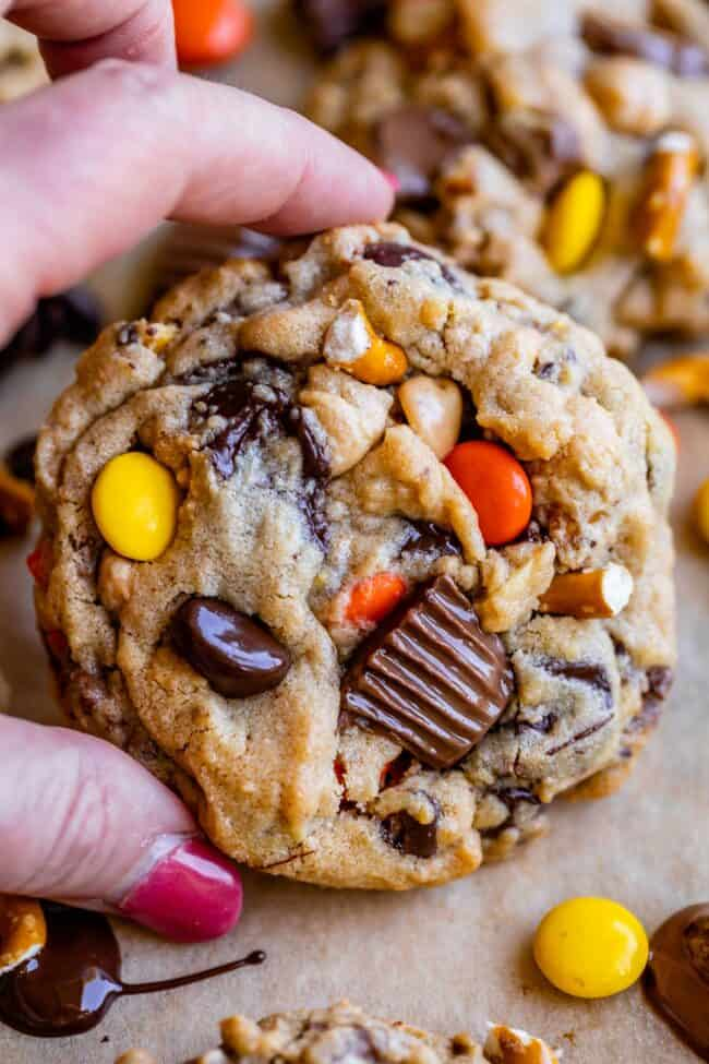 pretzel cookies with peanut butter and chocolate held in hand