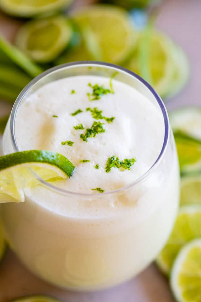 brazilian limeade in a glass with lime garnish