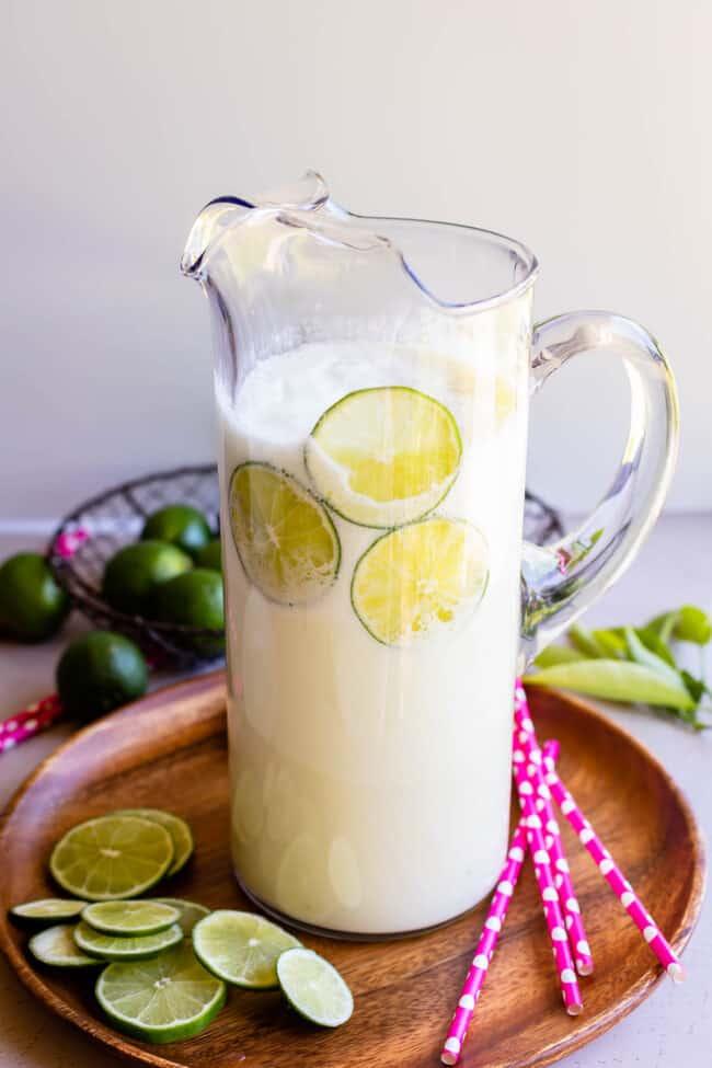 Brazilian lemonade recipe in a tall clear glass pitcher