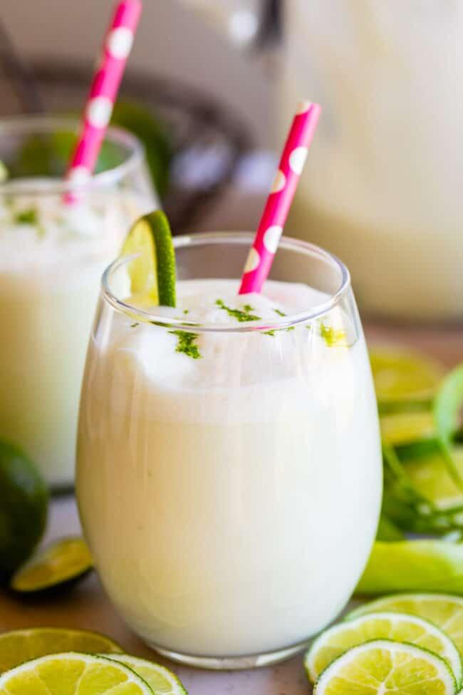 brazilian lemonade frozen limeade in a glass with a straw