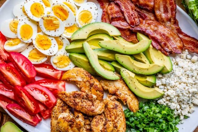 cobb salad recipe with ingredients on a white platter