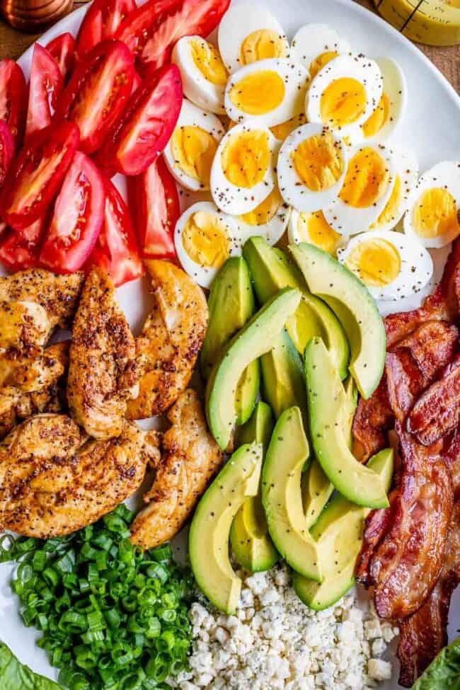 cobb salad ingredients sliced on a white platter