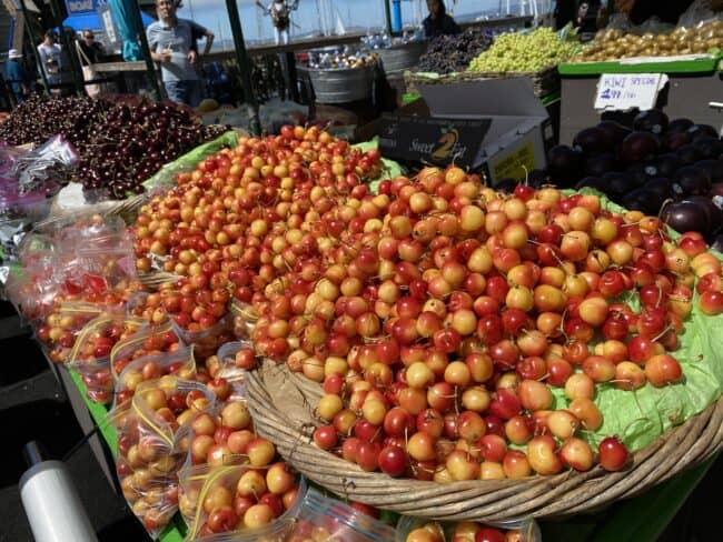 baskets of rainier cherries on Pier 39 in San Fransisco