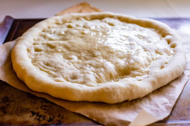 par baked pizza dough with oil rubbed on top