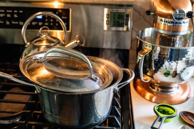 boiling soup on a stove with vented lid