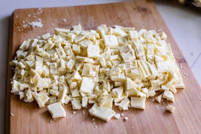 chopped white chocolate on a cutting board