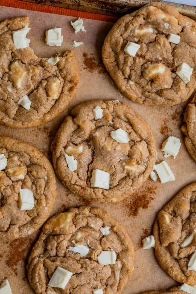 cinnamon white chocolate chip cookies on parchment paper