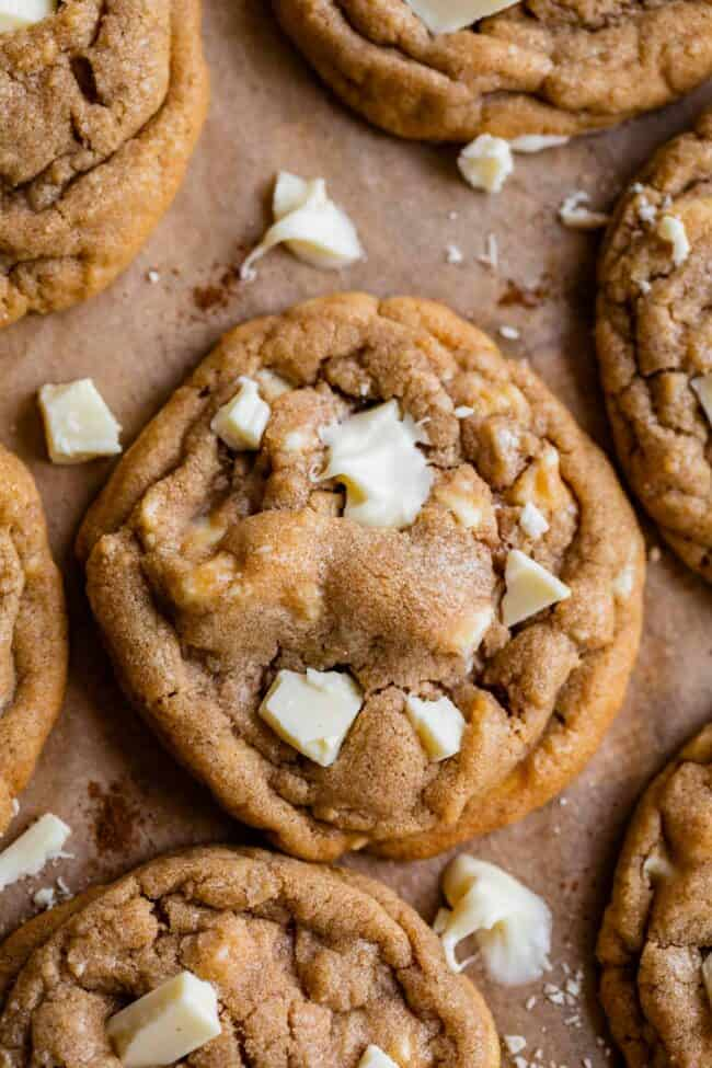 white chocolate chip cookies with crumbled white chocolate on pan