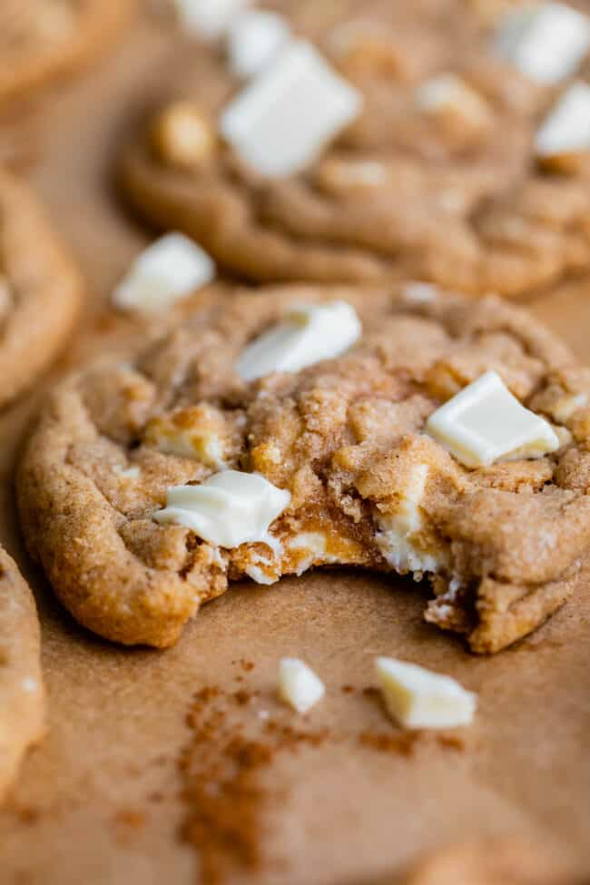 cinnamon and white chocolate cookies with a bite taken out