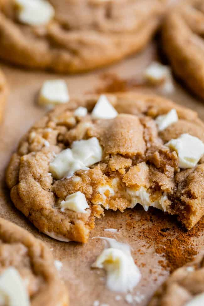cinnamon white chocolate chip cookies with a bite taken