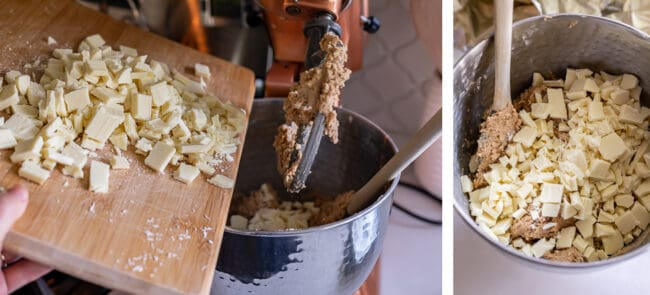 adding white chocolate from a cutting board to a stand mixer
