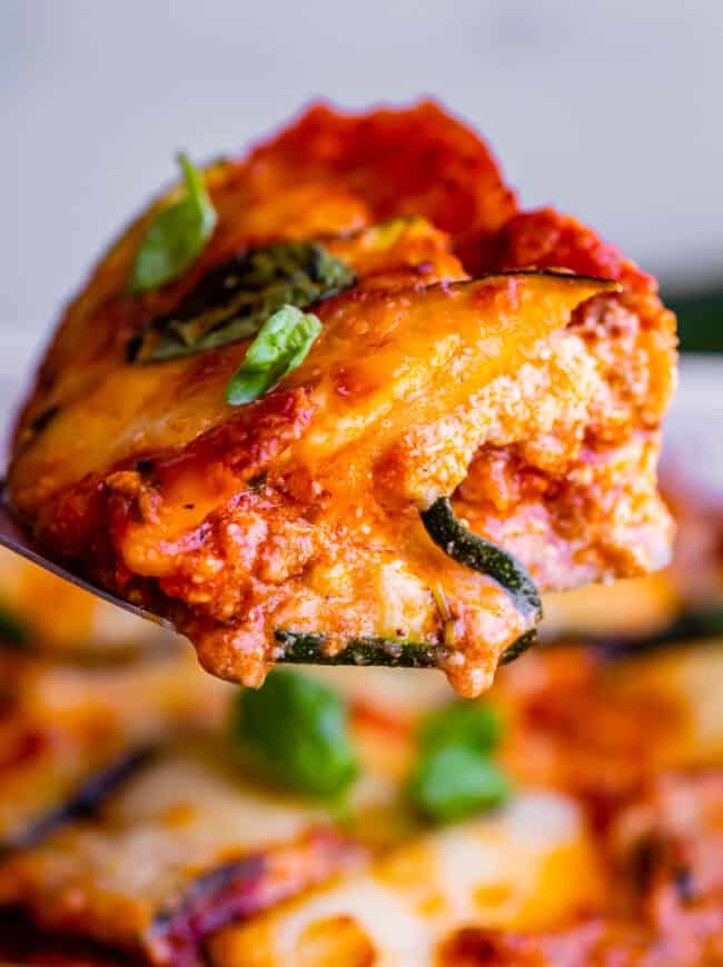 zucchini lasagna slice held up on a spatula