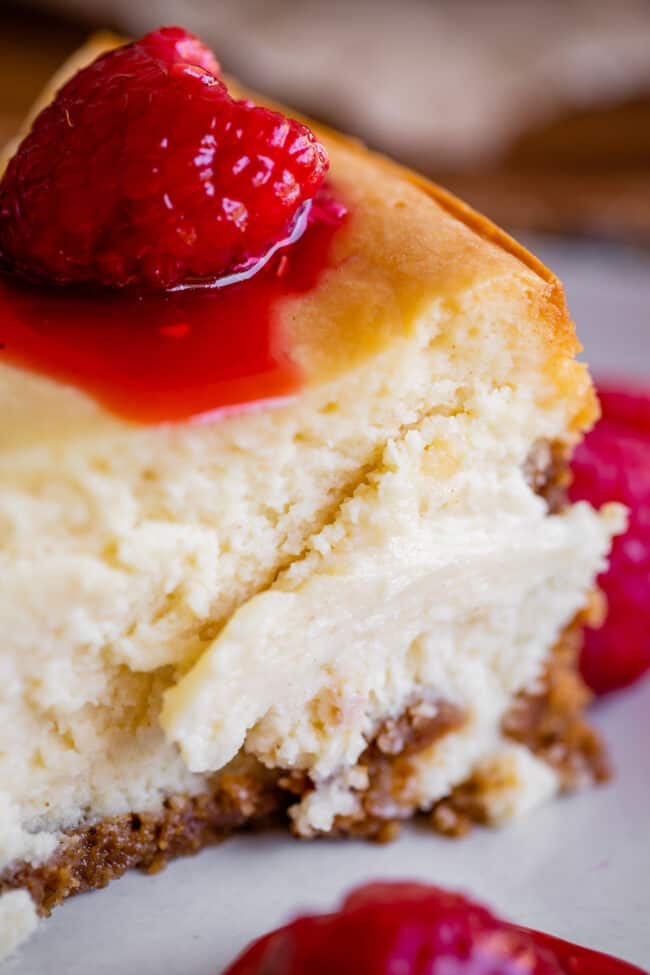 classic cheesecake recipe with raspberries on a plate
