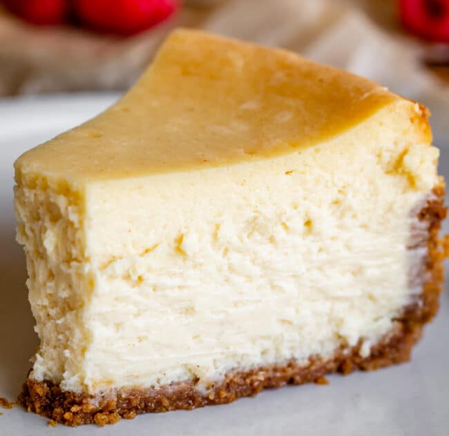 new york style cheesecake on a plate with no garnishes