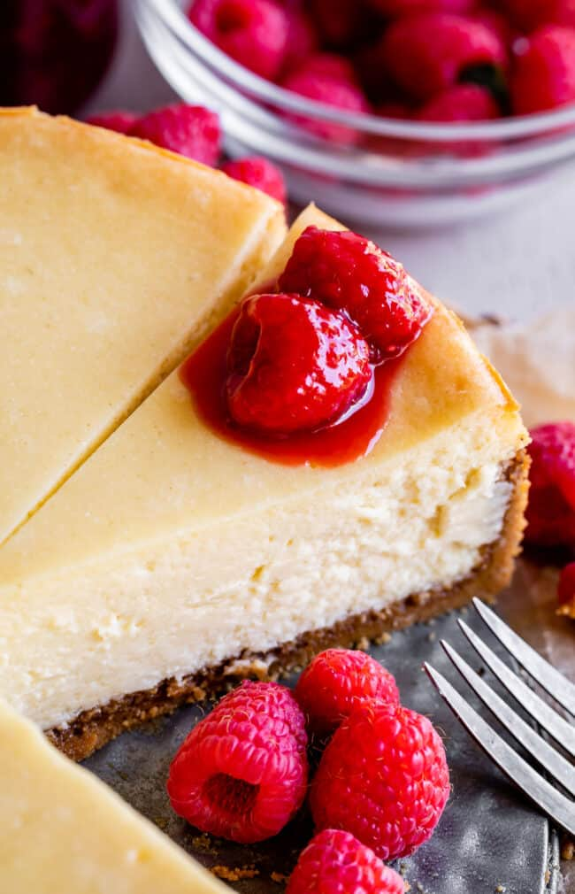 classic cheesecake in a pan with raaspberries