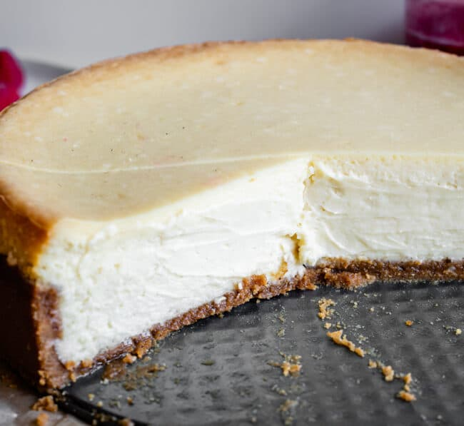 easy cheesecake in a pan with slices taken out