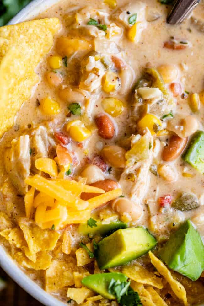 chicken and white bean chili with avocados and cheese