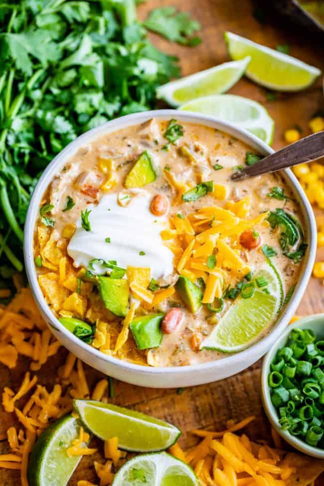 best white chicken chili in a white bowl with cilantro garnish