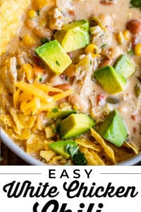 White chicken Chili with avocados and tortilla chips in a bowl