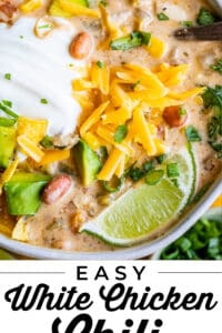 easy white chicken chili with sour cream and cheddar cheese with lime